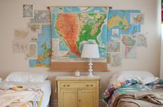 Map wall...yellow shabby chest and un-kept beds... so me!