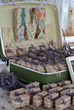 Lavender soap bars wrapped in kraft paper and displayed in a vintage suitcase - such a great favor idea wedding weddingfavors diywedding vintage lavender vintage
