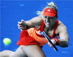 German Angelique Kerber returns a ball against Chinese Na Li during their match of the Madrid Masters on May 09, 2012 at the Magic Box (Caja Magica) sports complex in Madrid.