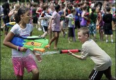 The soccer fields behind Manor School became a water park yesterday when more than 400 boys and girls paid homage to the man who invented the Super Soaker water gun.