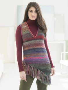 It's all about the layers this spring: crochet the Taos Slipover Vest for the perfect level of stylish warmth. Made with 6 balls of Amazing Yarn (shown in Acadia, Mauna Loa, Wildflowers, and Strawberry Fields) on a size crochet hook. Knit Vest Pattern, Crochet Poncho Patterns, Crochet Cardigan, Crochet Shawl, Crochet Vests, Crochet Sweaters, Knitting Patterns, Thread Crochet, Crochet Yarn