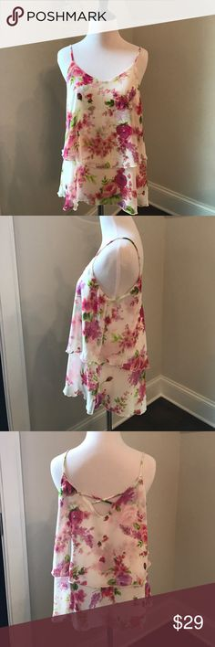 """Floral summery tank / camisole! Super cute! ☀️ Perfect for summer - or layering with a cardigan for work, this feminine and bright floral print spaghetti strap tank is super comfortable and versatile! NWOT! Purchased from a local boutique here in Charlotte. Faux double layered look. 100% polyester. Size Small. Lying flat, top of strap to longest part of hem about 24"""", armpit to armpit about 17"""". Newbury Kustom Tops Tank Tops"""