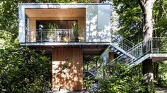 A pair of modern treehouses at the edge of a forest provide leafy retreats complete with kitchenette and bath. | www.facebook.com/SmallHouse...