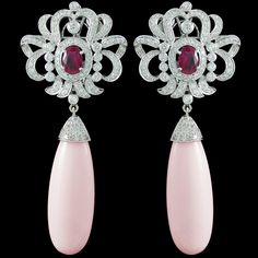 Our jewel of the month for DECEMBER 2013 is... A beautiful pair of Pink Coral, Ruby, and Diamond Earrings. Accompanied by 17.28 carats of Pink Coral, 1.30 carats of Rubies, and 2.64 carats of Diamonds.