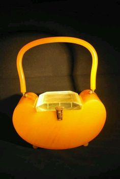 Butterscotch bakelite purse with clear lucite lid