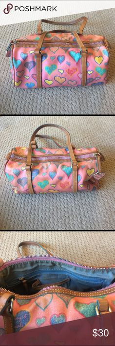 Dooney & Bourke purse Dooney & Bourke heart partnered purse. Two zip pockets and three small pockets inside. Used but good condition. Smoke free home. Dooney & Bourke Bags