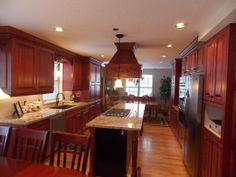 Kitchen on pinterest cherry cabinets maple kitchen and for Floors to match cherry cabinets