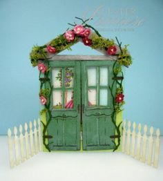Garden Party card - this somehow makes me think of building something like it over one of our mirror tiles, little garden doors that open, popsicle sticks or paint sticks for the bulk, chipboard for the doors, moss & flowers for the rest. ~Ariel