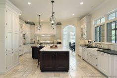 Traditional Two-Tone Kitchen Cabinets.  Dark contrasting island against crisp white cabinetry around perimeter of kitchen.