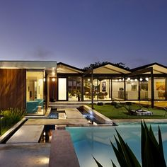 Front yard pool and the elegant entry to this renovated mid-century home in Southern California. Credit: Crosby Doe Associates, Inc.
