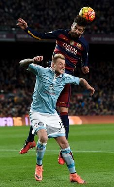 Barcelona's defender Gerard Pique (up) vies with Celta's Swedish forward John Guidetti during the Spanish league football match FC Barcelona vs RC Celta de Vigo at the Camp Nou stadium in Barcelona on February 14, 2016