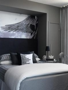 Nice charcoal gray bedroom. This room needs a pop of color