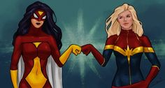 Spider-Woman and Captain Marvel - BFF fist bump.