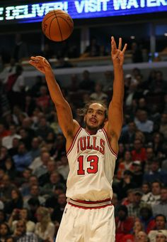 Joakim Noah #13 of the Chicago Bulls puts up a shot against the Dallas Mavericks at the United Center on November 28, 2012 in Chicago, Illinois.