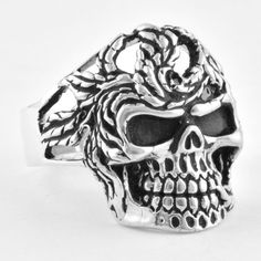 Beautiful 925 Sterling Silver Skull Ring. This skull ring is surrounded in serpent like branches and is crafted with intricate details. It is high polished and enameled to bring out the detail. It is made in USA and is available in all sizes. About Us: We are one of the largest