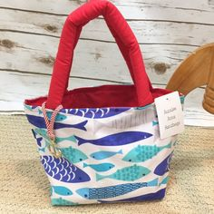 Handmade Anchor sea life fish mini tote bag This is an adorable tote. Perfect for a little girl who loves the beach or if you are taking the family on vacation your daughter can carry her own little tote. Measures 12 inches wide and 7 1/2 inches tall without the handles. The handles are 15 inches. Cute anchor charm detail. Auralee Anna Bags Totes