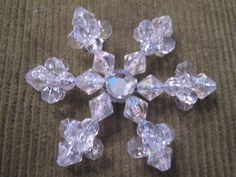 Beaded snowflake ornament #7.  Like the crystal in center, but would have to hot glue ahead of time?
