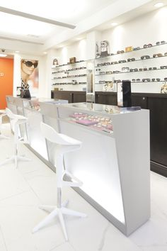 Optical bar height dispensing station with optical shelf display.  www.ioddisplays.com