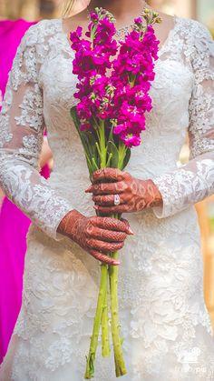 Megha + Colby #bride #bridetobe #catholicwedding #flowers #mehndi #candidphotography  #fridaypic www.fridaypic.com
