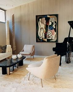 Musical Texture - This music room is decorated with mid-twentieth-century furnishings and toned down with textured materials, such as a Tibetan goatskin rug from Minassian's Paris shop; the 1930s Cubist painting is by Georges Valmier.
