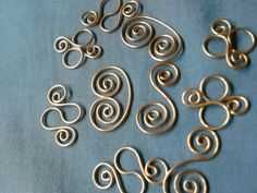 Copper Wire Wrap links connectors dangles for jewelry scrapbooking altered art hair accessories or home decor. $3.99, via Etsy.
