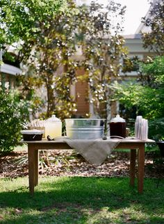 Cute decor and fans for guests at outdoor wedding -- Southern weddings - ceremony drink station