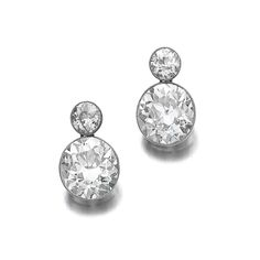 FROM AN ARISTOCRATIC FAMILY Pair of diamond earrings: Each millegrain-set with a circular-cut diamond, suspending a larger similarly cut diamond, post back fittings. Estimate    148,189 - 209,397USD  LOT SOLD. 268,458 USD