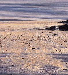 Streams in the sand at sunset. Godrevy, Cornwall
