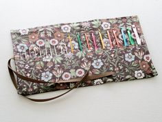 I love yarn crafts and have been knitting and crocheting for many years. In that time I have collected crochet hooks and knitting needles in a variety of sizes. I became frustrated, however, that there were no pretty, compact storage cases available. That's what prompted me to design my own.  I...