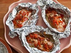 Giada's Salmon Baked in Foil : Individual packets of salmon and tomatoes mean fast cooking and clean-up.
