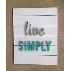 A wooden sign with some dimension.  Laser cut wood letters on simple wood plank sign.  I see crafting in my future...