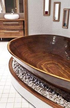 Check out this collection of 16 splendid wooden bathtubs as a focal point in the bathroom and choose one for the bathroom at home!