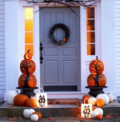 Stacked pumpkins in urns