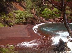 Red Sand Beach is a beautiful hidden cove cut into the Ka'uiki Head cinder cone. The deep blue ocean outside the cove pounds against the red lava coastline. The cove is protected on the ocean side by a high wall of jagged black lava rock making this a spectacular scene. The 10 minute hike to this cove is not for inexperienced hikers or children. Check with the locals to find out the best way to safely access this hidden treasure. Also, this is a nudist beach so beware.