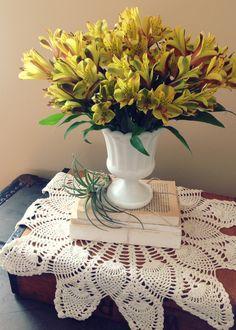 Simple floral arrangement of yellow alstroemeria.