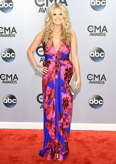 Nicolle Galyon~Posies please! The singer-songwriter brightened up the carpet in a plunging dress crafted from a pink and blue floral print.