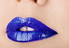 BLUE  Just as blue and red make purple, an azure lip glaze enhances the cool pink undertones of any lip color. Blue gloss also counteracts yellow stains on your teeth and gives the illusion of a brighter smile. Apply a sheer, shimmering formula over a fuchsia lip for a dazzling, holographic effect.