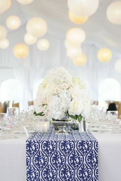 beautiful white and blue table setting.  classic with a modern twist.