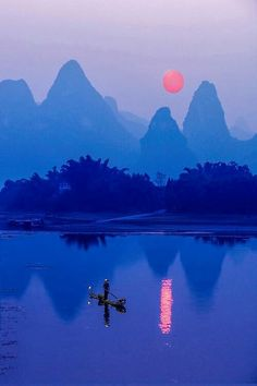 Sunset at Li River, Guilin, China  I really wanted to go here until I learned that tourists are constantly harassed by locals. Kinda ruins the beautiful scenery