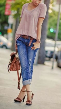 Pastel purple long blouse with blue stylish jeans and brown leather belt and hand bag and heels