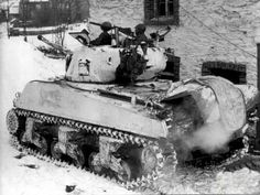 A Sherman tank painted white. Probably winter 44-45 Ardennes, Belgium.