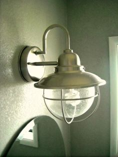 It's an outdoor light from Home Depot over a bathroom sink. and easy to afford 35 dollar outdoor light. Bathroom Renos, Master Bathroom, Simple Bathroom, Bathroom Ideas, Pool Bathroom, Bathroom Plans, Design Bathroom, Bathroom Wall, Bathroom Inspiration