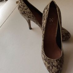 Vince Camuto snakeskin look pumps Vince Camuto classic pumps. Shades of black, gray and cream. 3 inch heel. Only worn once. Small puncture in the bottom of one shoe. Does not affect the wear at all. Tops and insides of shoes look brand new. Vince Camuto Shoes Heels