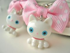 White Kitty and Bow Earrings kawaii sweet lolita fairy kei.  via Etsy.