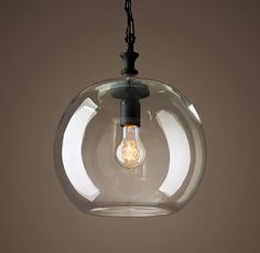 RH's Mason Glass Globe Filament Pendant:Simple shapes pair with rustic materials to beautifully showcase the warmth of Edison-style filament bulbs. The thickly walled cast-glass shades emulate the look of hand-blown vessels.