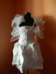 two different textures: paper and tulle. Love it