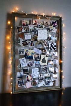 By removing the glass interior and adding wire, you can elevate an old frame into a beautifully crafted photo collage-esque display. Bonus: Add string lights around the frame to create a soft glow.