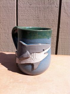 Shark Mug... Fucking buying this for myself as a shark week gift. Also to cheer me up after shark week fails again to actually portray sharks compassionately,