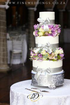 A tall elegant 3 tier wedding cake featuring beautiful floral divider arrangements. 3 Tier Wedding Cakes, Unique Wedding Cakes, Tall Cakes, Tiered Cakes, Beautiful Cakes, Our Wedding, Cake Decorating, Table Decorations, Bride