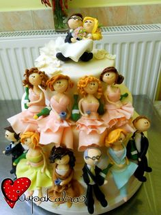 Fondant sculptures of the wedding party/family, each with their own special bottle.